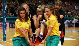 Netball Australia physio Alanna Antcliff assists with an ACL